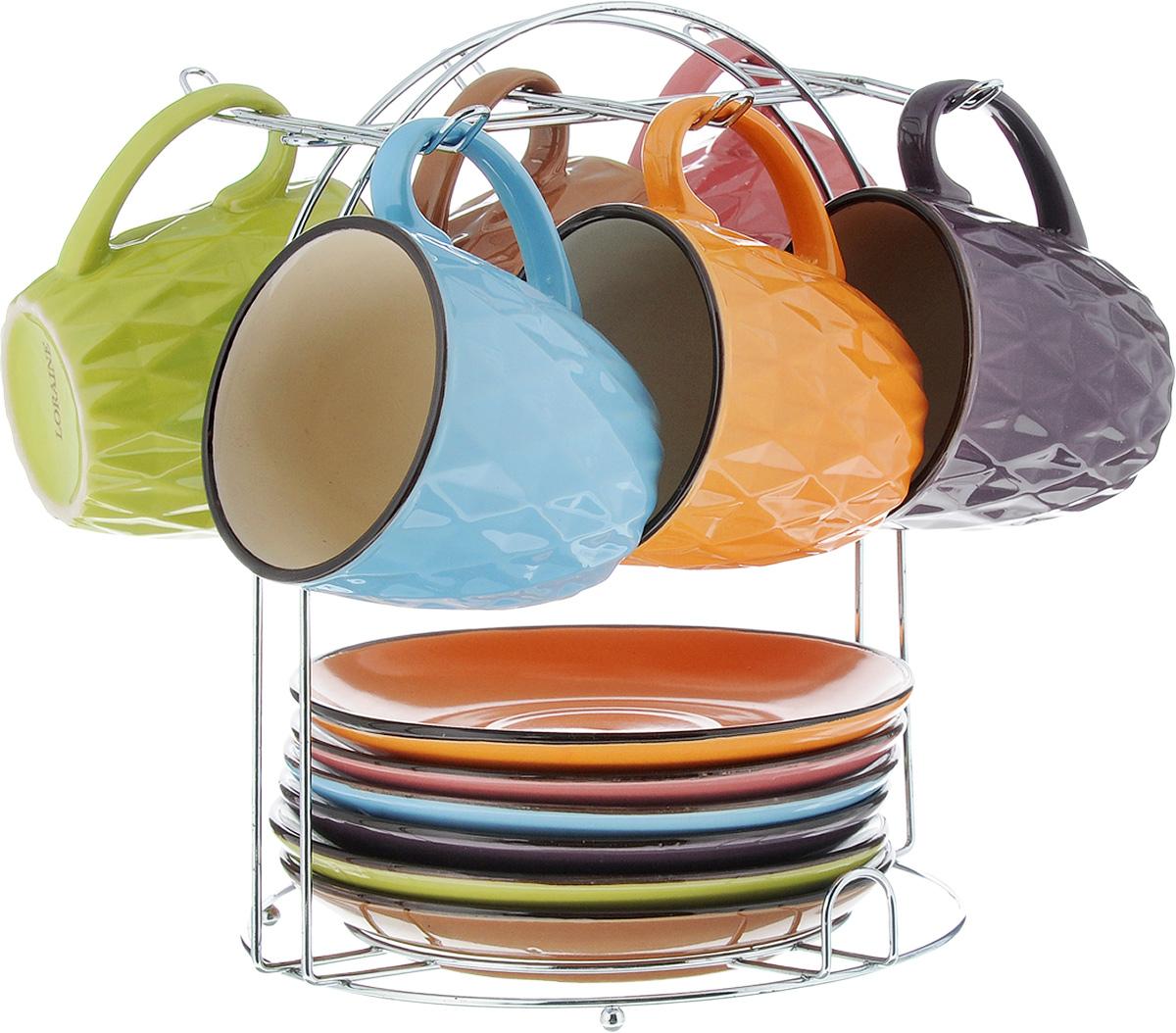 Набор чайный Loraine, на подставке, 13 предметов. 2464921395599Набор Loraine состоит из 6 чашек и 6 блюдец, изготовленных из высококачественной керамики разных цветов. Набор удобно располагается на металлической подставке. Изящный дизайн придется по вкусу и ценителям классики, и тем, кто предпочитает утонченность и изысканность. Он настроит на позитивный лад и подарит хорошее настроение с самого утра. Можно использовать в микроволновой печи и мыть в посудомоечной машине. Диаметр чашки (по верхнему краю): 7,5 см. Высота чашки: 7,5 см. Объем чашки: 220 мл. Диаметр блюдца: 14,5см. Высота блюдца: 2 см. Размер подставки: 19 х 19 х 22 см.