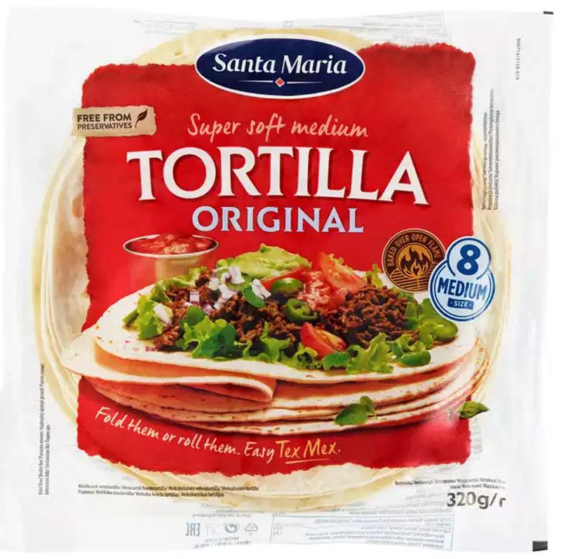 Santa Maria Тортилья пшеничная мексиканская, 320 г3312Тортилья - мягкая пшеничная лепешка. Широко используется в мексиканской кухне как самостоятельно блюдо, а также для приготовления роллов, буррито, фахита и других видов горячих и холодных блюд.При подогреве в духовке или микроволновой печи тортилья становится более мягкой и пышной. При поджаривании на сковороде без масла тортилья не сохнет, а покрывается хрустящей корочкой. При поджаривании на масле или во фритюре тортилья вздувается пузырями и становится хрустящей.