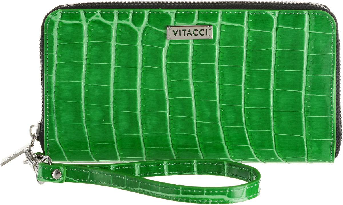 Кошелек женский Vitacci, цвет: зеленый. HS151MX3024820_WM_SHL_010Элегантный женский кошелек Vitacci выполнен из высококачественной натуральной кожи с тиснением под крокодила. Кошелек застегивается на застежку-молнию и имеет три отделения для купюр со средником на молнии. Внутри также располагаются двенадцать накладных открытых кармашков для карт и два больших накладных кармашка для бумаг и документов. Модель дополнена съемным ремешком на запястье. Практичность и уникальный стиль кошелька Vitacci подчеркнут вашу элегантность и превосходный вкус.