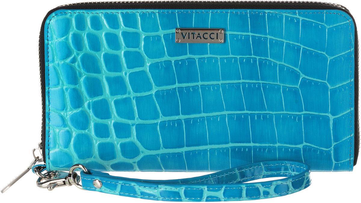 Кошелек женский Vitacci, цвет: голубой. HS133S98156Элегантный женский кошелек Vitacci выполнен из высококачественной натуральной кожи с тиснением под крокодила. Кошелек застегивается на застежку-молнию и имеет три отделения для купюр со средником на молнии. Внутри также располагаются двенадцать накладных открытых кармашков для карт и два больших накладных кармашка для бумаг и документов. Модель дополнена съемным ремешком на запястье. Практичность и уникальный стиль кошелька Vitacci подчеркнут вашу элегантность и превосходный вкус.