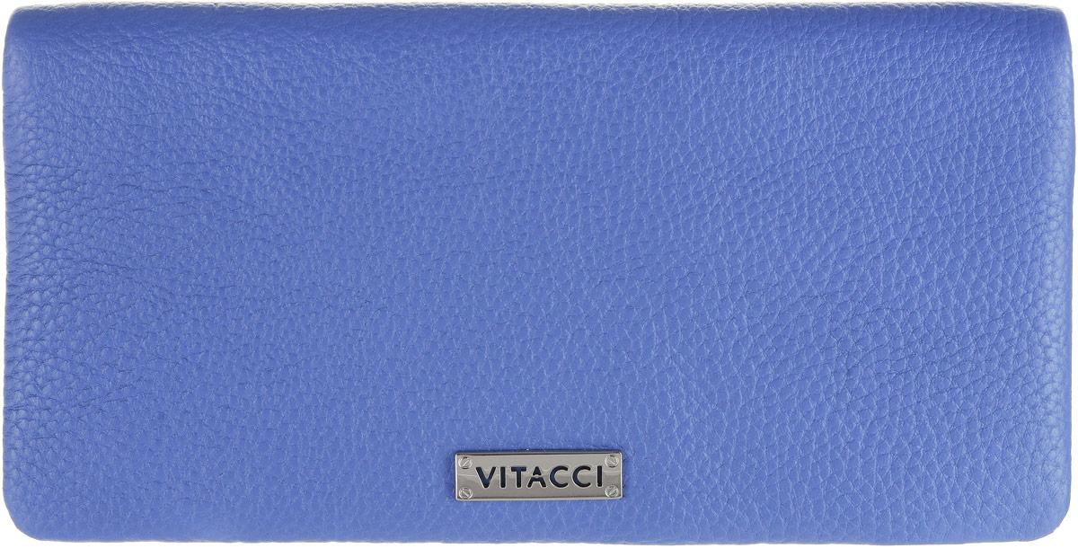Кошелек женский Vitacci, цвет: голубой. HS1401-022_516Элегантный женский кошелек Vitacci выполнен из высококачественной натуральной кожи. Кошелек застегивается на клапан с кнопкой и имеет три отделения для купюр. Внутри также располагаются двенадцать накладных открытых кармашков для карт, один из которых дополнен прозрачной вставкой, и прорезной карман на застежке-молнии. Кошелек дополнен отделением для мелочи на молнии, которое расположено на задней стенке. Практичность и уникальный стиль кошелька Vitacci подчеркнут вашу элегантность и превосходный вкус.