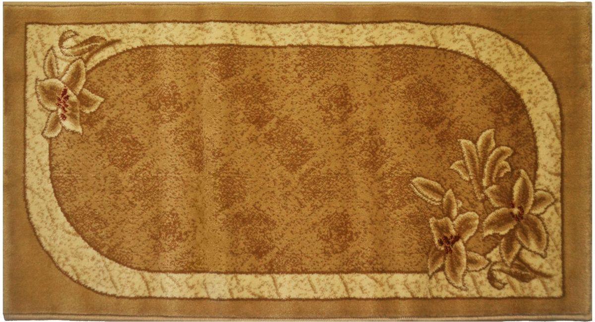 Ковер Kamalak Tekstil, 60 х 110 см. УК-0590УК-0590Ковер Kamalak Tekstil изготовлен из прочного синтетического материала heat-set, улучшенного варианта полипропилена (эта нить получается в результате его дополнительной обработки). Полипропилен износостоек, нетоксичен, не впитывает влагу, не провоцирует аллергию. Структура волокна в полипропиленовых коврах гладкая, поэтому грязь не будет въедаться и скапливаться на ворсе. Практичный и износоустойчивый ворс не истирается и не накапливает статическое электричество. Ковер обладает хорошими показателями теплостойкости и шумоизоляции. Оригинальный рисунок позволит гармонично оформить интерьер комнаты, гостиной или прихожей. За счет невысокого ворса ковер легко чистить. При надлежащем уходе синтетический ковер прослужит долго, не утратив ни яркости узора, ни блеска ворса, ни упругости. Самый простой способ избавить изделие от грязи - пропылесосить его с обеих сторон (лицевой и изнаночной). Влажная уборка с применением шампуней и моющих средств не противопоказана. Хранить рекомендуется в свернутом рулоном виде.