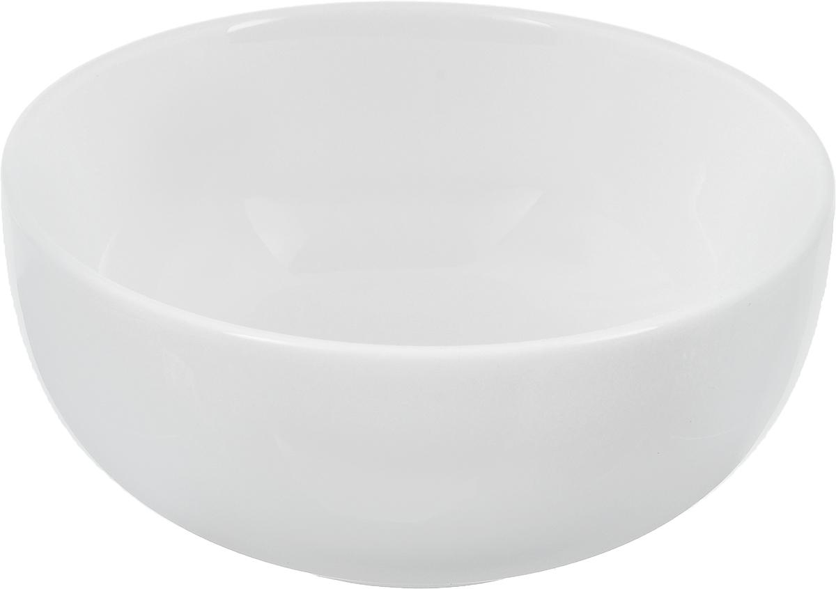 Салатник Ariane Прайм, 420 мл115510Салатник Ariane Прайм, изготовленный из высококачественного фарфора с глазурованным покрытием, прекрасно подойдет для подачи различных блюд: закусок, салатов или фруктов. Такой салатник украсит ваш праздничный или обеденный стол.Можно мыть в посудомоечной машине и использовать в микроволновой печи.Диаметр салатника (по верхнему краю): 13,5 см.Диаметр основания: 6,5 см.Высота стенки: 6,5 см.Объем салатника: 420 мл.