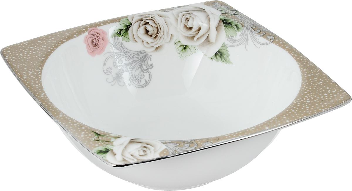 Салатник Florance, 14 х 14 смПЦ1853ЛМСалатник Florance, изготовленный из высококачественного фарфора с глазурованным покрытием, прекрасно подойдет для подачи различных блюд: закусок, салатов или фруктов. Такой салатник украсит ваш праздничный или обеденный стол.Можно мыть в посудомоечной машине и использовать в микроволновой печи.Размер салатника (по верхнему краю): 14 х 14 см.Высота стенки: 5 см.