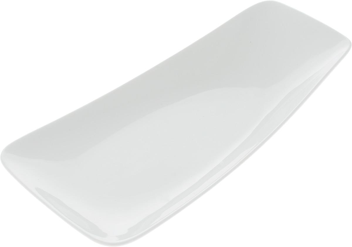 Блюдо Ariane Rectangle, 29 х 15,5 см115510Оригинальное блюдо Ariane Rectangle прямоугольной формы изготовлено из высококачественного фарфора с глазурованным покрытием и имеет приподнятый край. Изделие идеально подходит для сервировки закусок и других блюд. Такое блюдо прекрасно впишется в интерьер вашей кухни и станет достойным дополнением к кухонному инвентарю. Можно мыть в посудомоечной машине и использовать в микроволновой печи. Размер блюда (по верхнему краю): 19 х 15,5 см. Максимальная высота блюда: 5 см.