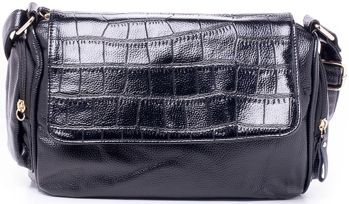 Сумка женская Baggini, цвет: черный. 25044/10EQW-M710DB-1A1Небольшая, но вместительная классическая сумка Baggini исполнена из высококачественной плотной экокожи. Сумка имеет одно главное отделение на застежке-молнии, в котором находятся: два накладных кармашка для сотового телефона и мелочей, один прорезной на молнии. Перед главным отделением, снаружи, располагается большой карман на застежке-молнии. Карман и отделение защищены от нежелательного проникновения закрывающей их крышкой на магнитной кнопке украшенной фурнитурой. Сумка обладает удобным регулируемым плечевым ремнем для переноски. Сзади обнаруживается еще один прорезной карман на молнии для быстрого доступа к часто используемым вещам.