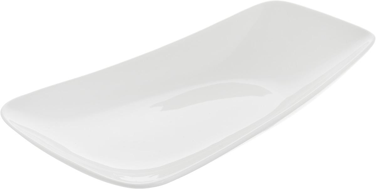 Тарелка Ariane Rectangle, 24 х 13 см115510Оригинальная тарелка Ariane Rectangle изготовлена из высококачественного фарфора с глазурованным покрытием и имеет приподнятый край. Изделие идеально подходит для сервировки закусок и других блюд. Такая тарелка прекрасно впишется в интерьер вашей кухни и станет достойным дополнением к кухонному инвентарю. Можно мыть в посудомоечной машине и использовать в микроволновой печи. Размер тарелки (по верхнему краю): 24 х 13 см. Максимальная высота тарелки: 4 см.