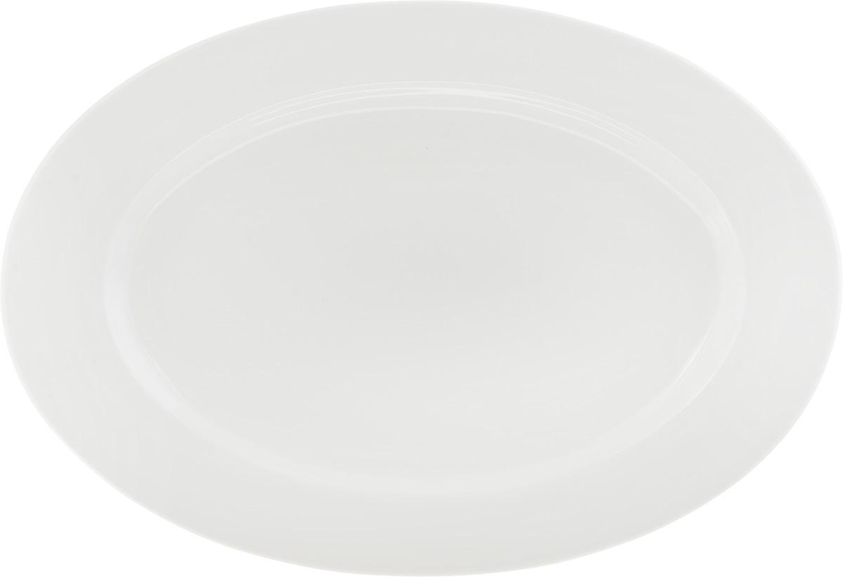 Блюдо Ariane Прайм, 22 x 32 см115510Овальное блюдо Ariane Прайм выполнено из фарфора с глазурованным покрытием. Данное блюдо сочетает в себе оригинальный дизайн с максимальной функциональностью, оно отлично подойдет для подачи закусок, сладостей или фруктов. Можно использовать в СВЧ-печах и посудомоечных машинах.Размер блюда: 32 см х 22 см х 2 см.