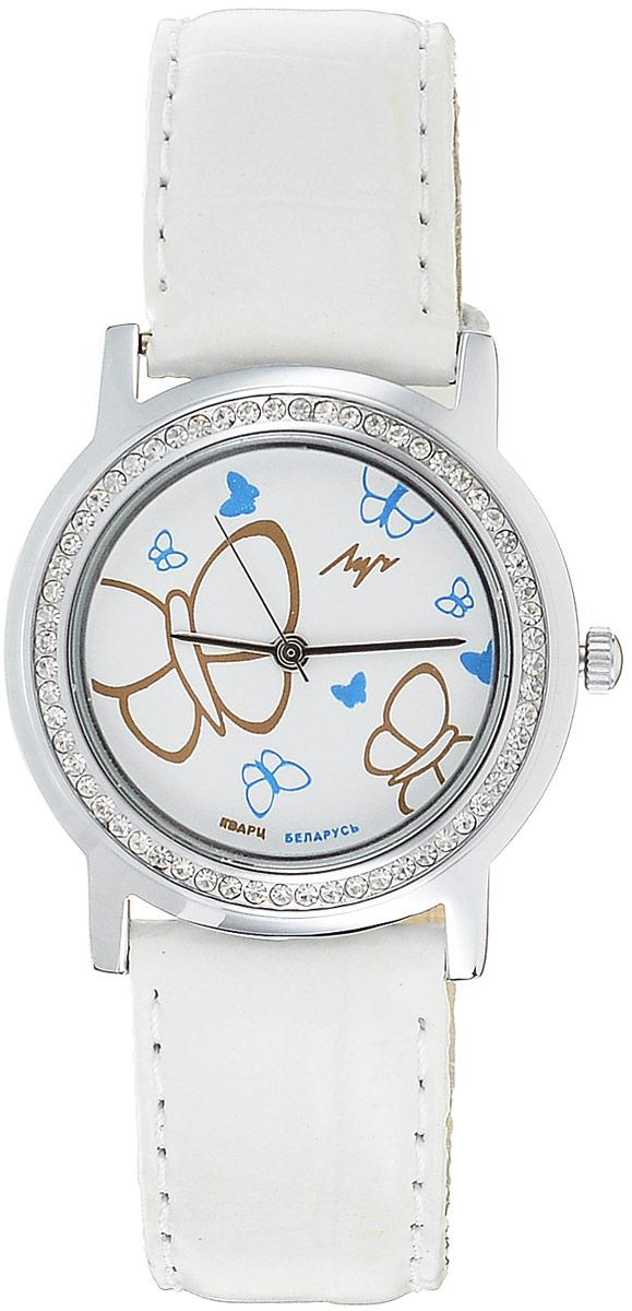 Наручные часы для девочки Луч, цвет: белый, серебристый. 74381853BM8434-58AEКварцевые часы для девочки Луч с японским механизмом Miyota и центральной секундной стрелкой. Выдерживают воздействие многократных ударов с ускорением 150м/с при длительности ударов от 2 до 15 м/с. Имеют круглый металлический корпус с плоским силикатным устойчивым к царапинам стеклом, украшенный стразами по периметру. Покрытие: хром. На циферблате изображены бабочки. Часы выполнены с ремешком из натуральной кожи. Продолжительность непрерывной работы 12 месяцев. Сменная батарея.