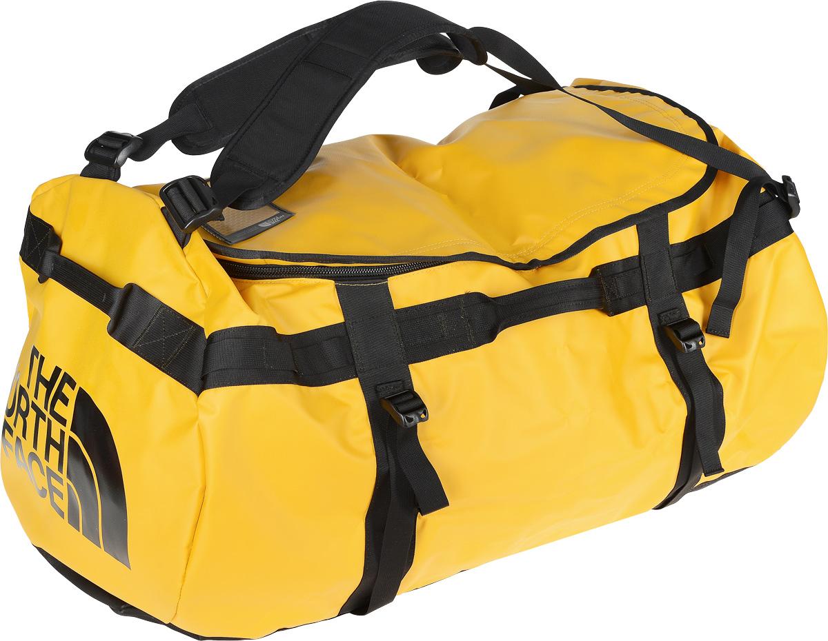 Сумка-рюкзак The North Face, цвет: желтый, 132 л. CWV7_ZU3T0CWV7ZU3Удобная экспедиционная сумка-рюкзак The North Face, вместительная модель, которая подойдет на любой жизненный случай. Изготовлена модель из сочетания водонепроницаемого баллистического нейлона и полиэстера с TPE ламинированием. Корпус изделия укреплен поперечными лентами с двойной отстрочкой и по бокам четырьмя лентами для утяжки.Модель имеет улучшенные эргономичные плечевые лямки, новые укрепленные боковые ручки, которые позволяют с удобством переносить или тащить тяжелые грузы. Основное отделение сумки застегивается на U-образную молнию с защитой от влаги.Верхняя крышка сумки дополнена небольшим отделением для бейджа с персональными данными, а с внутренней стороны имеет карман на молнии из сетчатой ткани. С внутренней стороны сумка дополнена накладным открытым карманом из сетчатой ткани. Оформлена модель износостойким принтом с логотипом бренда.