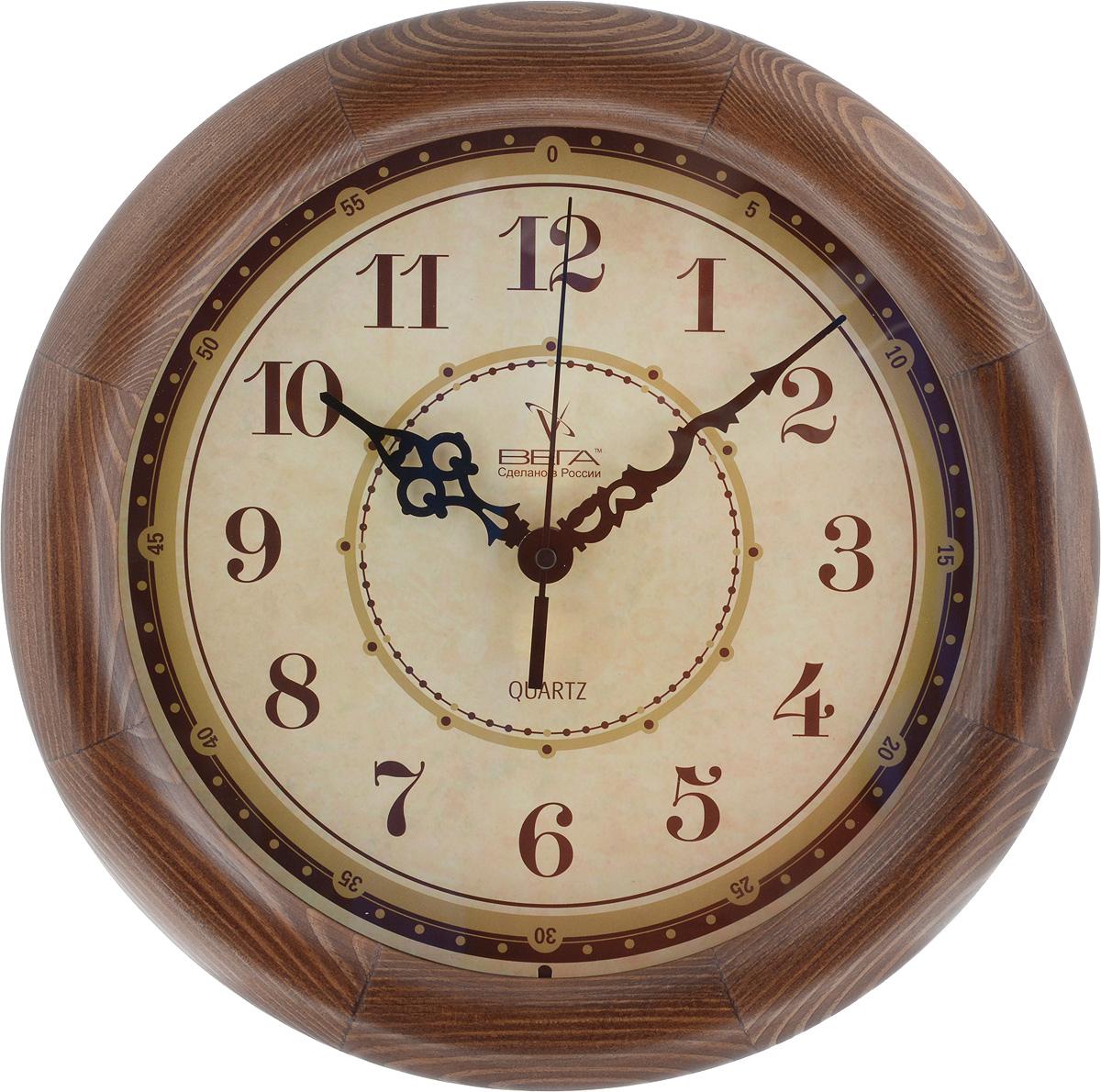 Часы настенные Вега Классика, цвет: темно-коричневый, диаметр 30 см94672Настенные кварцевые часы Вега Классика, изготовленные из дерева, прекрасно впишутся в интерьер вашего дома. Часы имеют три стрелки: часовую, минутную и секундную, циферблат защищен прозрачным стеклом. Часы работают от 1 батарейки типа АА напряжением 1,5 В (не входит в комплект).Диаметр часов: 30 см.