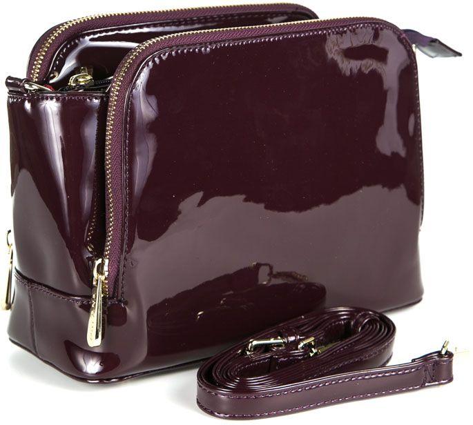 Сумка женская Milana, цвет: бордовый. 162656-1-751BM8434-58AEУдобная женская сумка Milana изготовлена из искусственной кожи. Внутренняя подкладка выполнена из искусственного шелка. Сумка закрывается на застежку молнию. Внутри имеется одно основное отделение, которое оснащено одним втачным карманом на молнии и двумя накладными открытыми кармашками. Внешняя сторона сумки дополнена двумя боковыми карманами на молниях. Модель оснащена съемным плечевым ремешком.Оригинальный аксессуар позволит вам завершить образ и быть неотразимой.