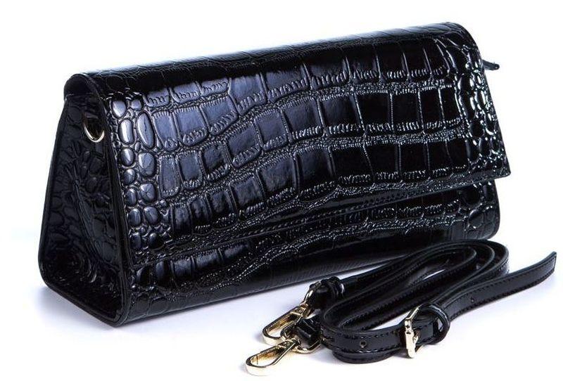 Клатч женский Milana, цвет: черный. 162663-1-71071069с-2Удобная женская сумка-клатч Milana изготовлена из искусственной кожи. Внутренняя подкладка выполнена из искусственного шелка. Сумка закрывается на магнитный замок. Внутри имеется одно основное отделение. Модель оснащена наплечным съемным ремешком, а такжесумку можно носить как клатч в руке.Оригинальный аксессуар позволит вам завершить образ и быть неотразимой.