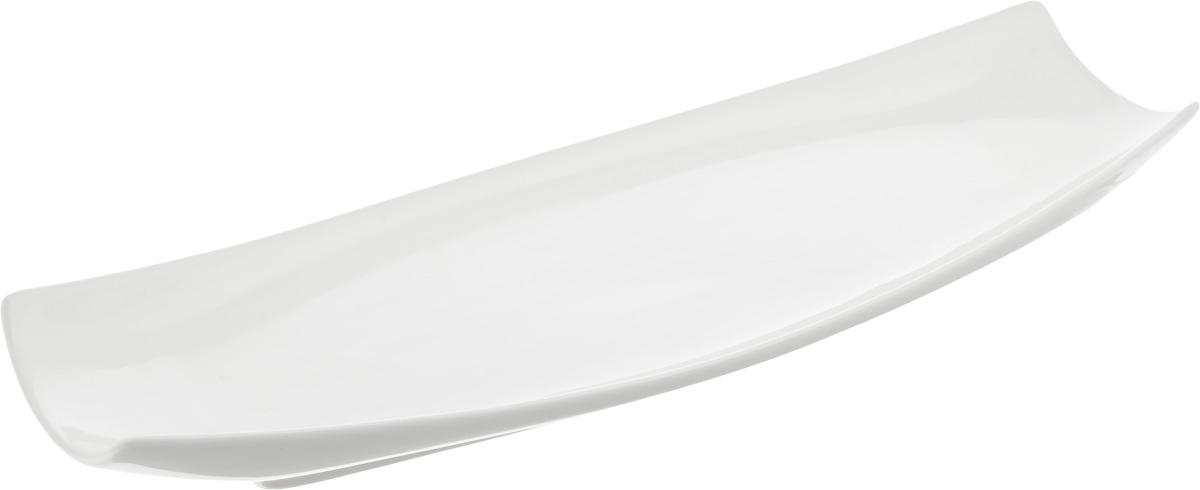 Блюдо Wilmax, 40 х 13 см115510Оригинальное прямоугольное блюдо Wilmax, изготовленное из фарфора с глазурованным покрытием, прекрасно подойдет для подачи нарезок, закусок и других блюд. Фарфор от Wilmax изготовлен по уникальному рецепту из сплава магния и алюминия, благодаря чему посуда обладает характерной белизной, прочностью и устойчивостью к сколами. Блюдо украсит ваш кухонный стол, а также станет замечательным подарком к любому празднику. Можно мыть в посудомоечной машине и использовать в микроволновой печи.