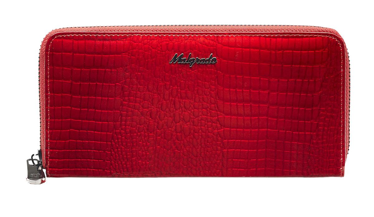 Кошелек женский Malgrado, цвет: красный. 77006-4477-080-06Женский кошелек Malgrado выполнен из натуральной лаковой кожи с тиснением под рептилию. Под молнией внутри кошелька 5 отделений, одно из них на молнии. Также на одной жесткой перегородке есть 1 прозрачный кармашек под карточки. В кошельке на боковых стенках есть по 4 кармашка для карточек и по 1 продольному кармашку. Закрывается на металлическую молнию.