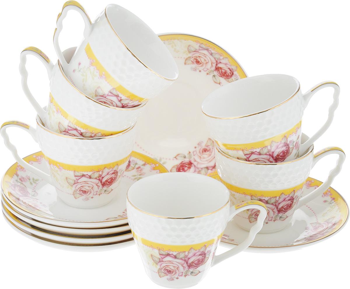 Набор кофейный Loraine Розы, 12 предметов. 25788VT-1520(SR)Кофейный набор Loraine Розы состоит из 6 чашек и 6 блюдец. Изделия выполнены из высококачественного костяного фарфора, оформлены золотистой каймой и цветочным рисунком. Такой набор станет прекрасным украшением стола и порадует гостей изысканным дизайном и утонченностью. Набор упакован в подарочную коробку, задрапированную внутри белой атласной тканью. Каждый предмет надежно зафиксирован внутри коробки. Кофейный набор Loraine Розы идеально впишется в любой интерьер, а также станет идеальным подарком для ваших родных и близких. Объем чашки: 90 мл. Диаметр чашки (по верхнему краю): 6,2 см. Высота чашки: 5,5 см. Диаметр блюдца (по верхнему краю): 11,2 см. Высота блюдца: 1,5 см.
