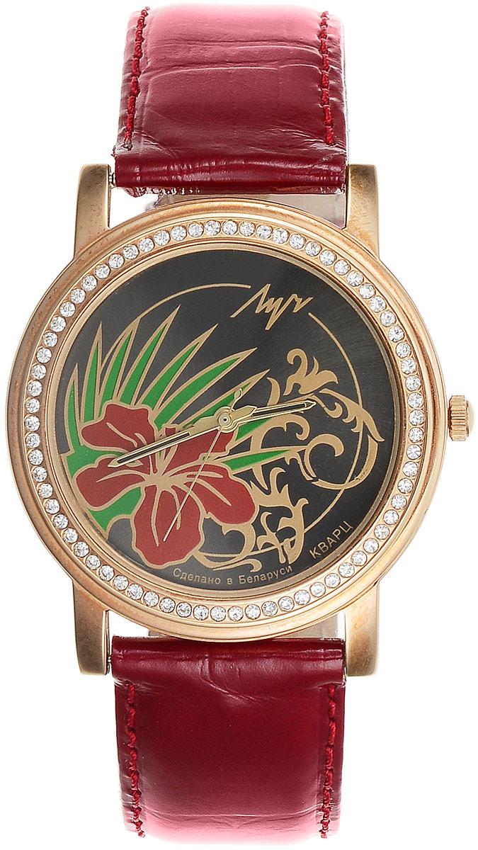 Наручные часы женские Луч, цвет: бордовый, черный, золотистый, зеленый. 373748781BM8434-58AEЖенственные кварцевые часы Луч с японским механизмом Miyota и центральной секундной стрелкой выполнены с корпусом золотистых тонов. Круглый циферблат с изображением стилизованных цветов прикрыт силикатным стеклом и оформлен кристаллами по периметру. Покрытие: червоное золото. Ремешок выполнен с имитацией крокодиловой кожи, покрыт лаком. Часы выдерживают воздействие многократных ударов с ускорением 150м/с при длительности ударов от 2 до 15 м/с.