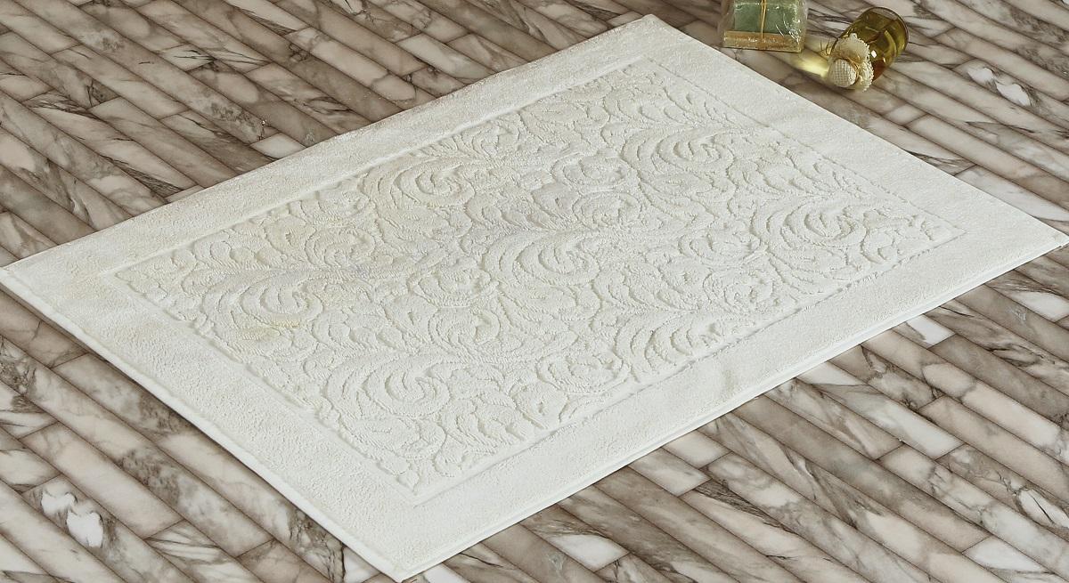 Коврик для ванной Karna Gonca. Esra , цвет: кремовый, 50 х 70 см2026/CHAR005Коврик-полотенце для ванной Karna выполнен из высококачественного хлопкового волокна. Имеет рельефный рисунок. Высочайшее качество материала гарантирует безопасность для всех членов семьи. Коврик не аллергенен, имеет высокую воздухопроницаемость и долгий срок использования ткани.