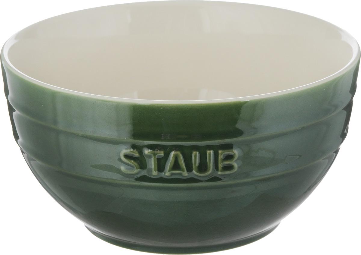 Миска Staub, цвет: зеленый, молочный, диаметр 17 см115510Миска Staub изготовлена из глины, покрытой эмалью из стеклянного порошка. Изделие очень функциональное, оно пригодится на кухне для самых разнообразных нужд: в качестве салатника, миски, тарелки.Можно мыть в посудомоечной машине.Можно использовать в духовке, микроволновой печи и морозильной камере.Диаметр миски (по верхнему краю): 17 см. Высота стенки: 9 см. Объем: 1,2 л.