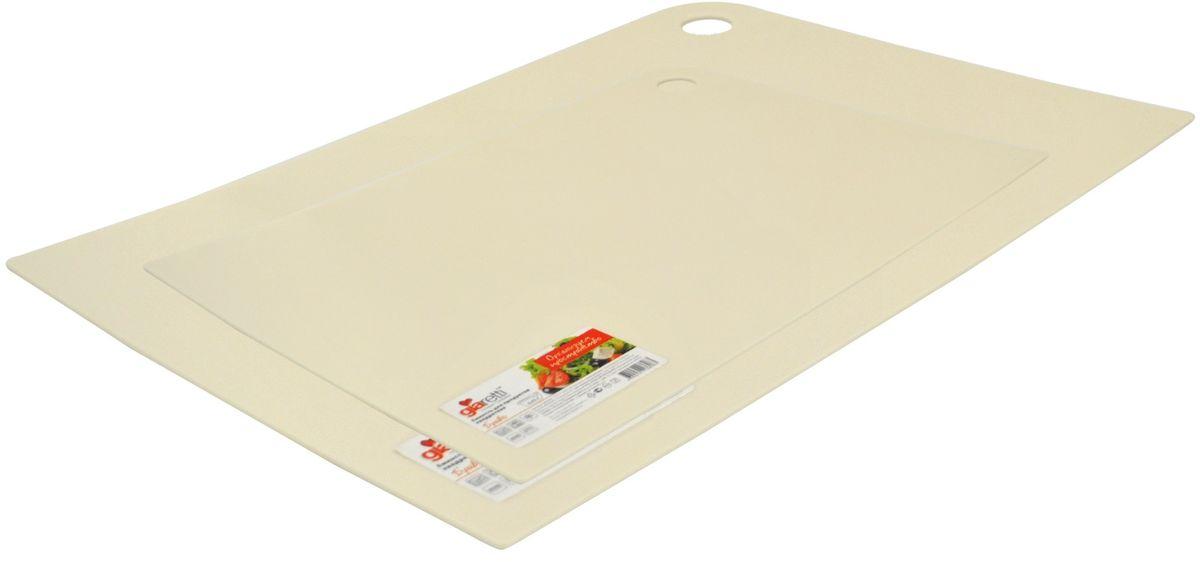 Набор разделочных досок Giaretti Delicato, гибкие, цвет: сливочный, 2 предмета54 009312Маленькие и большие, под хлеб или сыр, овощи или мясо. Разделочных досок много не бывает. Giaretti предлагает новинку – гибкие доски.Преимущества:-не скользит по поверхности стола - вы можете резать продукты и не отвлекаться на мелочи; -удобно использовать - на гибкой доске вы сможете порезать продукты, согнув доску переложить их в блюдо и не рассыпать содержимое;-легкие доски займут мало места на вашей кухне;-легко моются в посудомоечной машине; -оптимальный размер доски позволят вам порезать небольшой кусок сыра или нашинковать много овощей. В набор входит две доски: 25 x 17 см, 35 x 25 см.