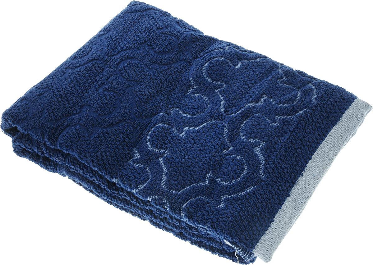 Полотенце махровое Toalla Лагуна, цвет: темно-синий, 70 x 140 см391602Полотенце махровое Toalla Лагуна выполнено из 100% натурального египетского хлопка. Изделие оформлено изысканным рельефным орнаментом. Ткань полотенца обладает высокой плотностью и мягкостью, отличается высоким качеством и длительным сроком службы. В процессе эксплуатации материал становится только мягче и приятней на ощупь. Египетский хлопок не содержит линта (хлопковый пух), поэтому на ткани не образуются катышки даже после многократных стирок и длительного использования. Сверхдлинные волокна придают ткани характерный красивый блеск. Полотенце отлично впитывает влагу и быстро сохнет. Такое полотенце красиво дополнит интерьер ванной комнаты и станет практичным приобретением.
