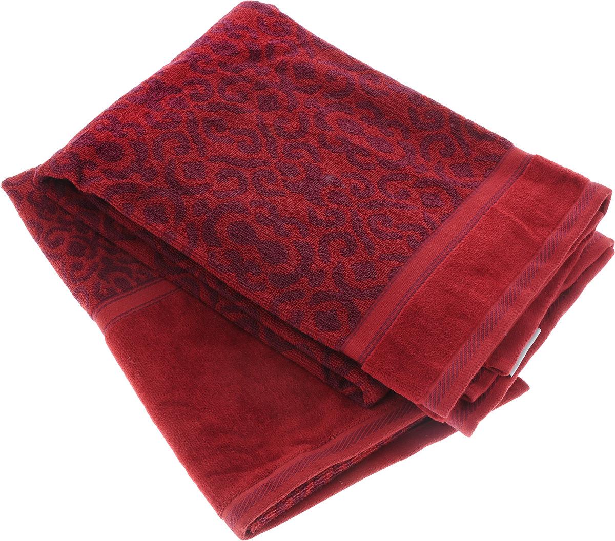 Набор махровых полотенец Toalla Флора, цвет: бордовый, фиолетовый, 2 шт68/5/4Набор Toalla Флора состоит из 2 прямоугольных махровых полотенец, выполненных из 100% хлопка. Ткань полотенец обладает высокой плотностью и мягкостью, отличается высоким качеством и длительным сроком службы. В процессе эксплуатации материал становится только мягче и приятней на ощупь. Египетский хлопок не содержит линта (хлопковый пух), поэтому на ткани не образуются катышки даже после многократных стирок и длительного использования. Сверхдлинные волокна придают ткани характерный красивый блеск. Полотенца отлично впитывают влагу и быстро сохнут. Такой набор красиво дополнит интерьер ванной комнаты и станет практичным приобретением. Полотенца оформлены изысканными узорами.