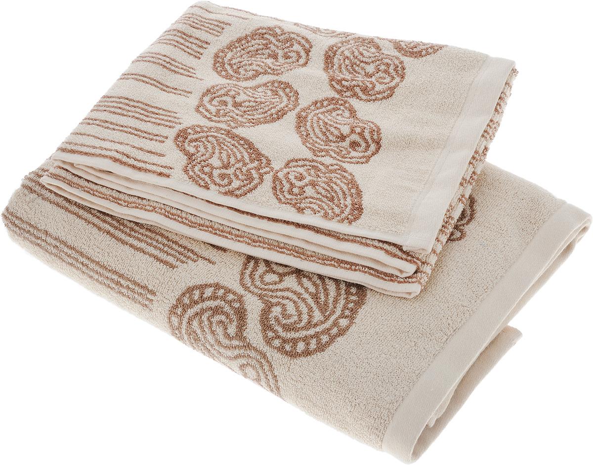 Набор махровых полотенец Toalla Аква, цвет: песочный, коричневый, 2 шт68/5/2Набор Toalla Аква состоит из 2 прямоугольных махровых полотенец, выполненных из 100% хлопка. Ткань полотенец обладает высокой плотностью и мягкостью, отличается высоким качеством и длительным сроком службы. В процессе эксплуатации материал становится только мягче и приятней на ощупь. Египетский хлопок не содержит линта (хлопковый пух), поэтому на ткани не образуются катышки даже после многократных стирок и длительного использования. Сверхдлинные волокна придают ткани характерный красивый блеск. Полотенца отлично впитывают влагу и быстро сохнут. Такой набор красиво дополнит интерьер ванной комнаты и станет практичным приобретением. Полотенца оформлены изысканными узорами и принтом в полоску.