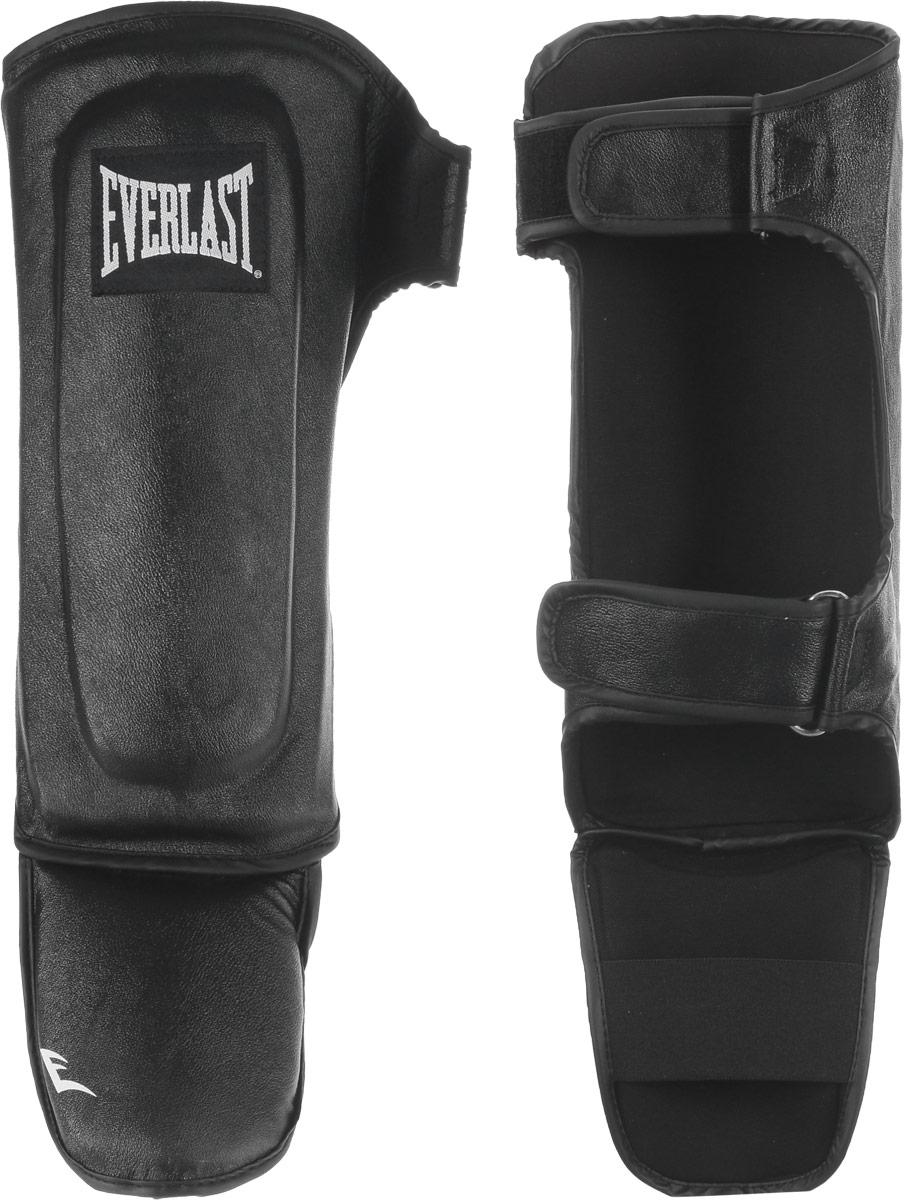 Защита голени и стопы Everlast Martial Arts Leather Shin-Instep, цвет: черный, белый. Размер S/MWRA523700Everlast Martial Arts Leather Shin-Instep - это надежная защита для голени и стопы. Верх выполнен из натуральной кожи. Защита закрепляется на ноге при помощи ремней на липучках. Двойной защитный слой обеспечивает комфорт и надежную защиту от травм и ушибов. Идеально подходит для работы в спаррингах.