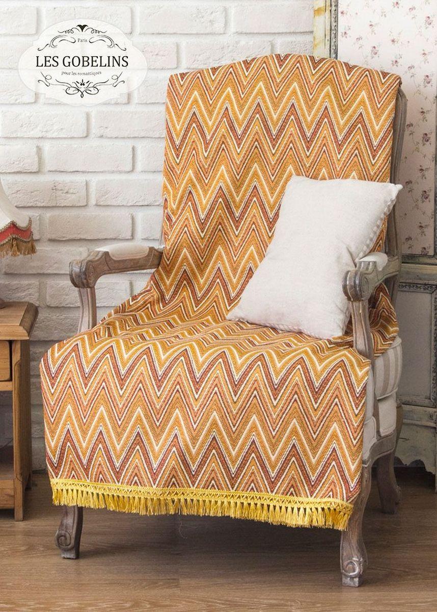 Покрывало на кресло Les Gobelins Zigzag, цвет: коричневый, 50 х 120 смFA-5125 WhiteПокрывало на кресло Les Gobelins Zigzag с ярким геометрическим рисунком привлечет к себе внимание и органично впишется в интерьер комнаты. Изделие изготовлено из высококачественной ткани гобелен и оформлено бахромой и кисточками. Необычайная красота сочетается в этом покрывале с высокой прочностью и долговечностью, а свойство гобелена по-разному проявлять себя в зависимости от освещения помещения позволяет открывать все новые и новые детали, которые, как казалось, раньше скрывал гобелен.Красочное и приятное на ощупь покрывало сделает интерьер спальни, детской или гостиной уютнее и своеобразнее. Состав материала: 52% хлопок, 48% полиэстер.