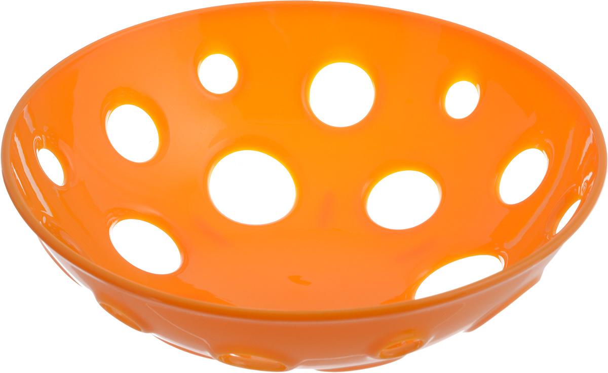 Миска для фруктов и овощей Tescoma Vitamino, глубокая, цвет: оранжевый, диаметр 24 см115510Глубокая миска Tescoma Vitamino выполнена из высококачественного прочного пластика. Изделие прекрасно подходит для хранения свежих овощей и фруктов, например, яблок, груш, слив, мандаринов, помидоров, а также для ополаскивания их под проточной водой. Миска оснащена большими отверстиями для максимального доступа воздуха к хранимым продуктам. Фрукты и овощи в таком изделии дозревают естественным путем и дольше остаются свежими.Подходит для холодильника и посудомоечной машины.Размер миски: 24 х 24 х 7,5 см.