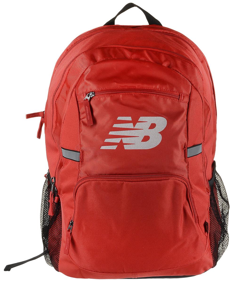 Рюкзак New Balance Accelerator Backpack, цвет: красный, черный. 500100/RB23008Стильный городской рюкзак New Balance Accelerator Backpack, выполненный из полиэстера и нейлона, оформлен фирменной символикой.Изделие имеет три отделения, которые закрываются на застежки-молнии. Одно отделение предназначено для ноутбука. Внутри среднего отделения находятся три накладных кармана, один из которых на застежке-молнии. Внутри третьего расположены шесть эластичных фиксаторов и накладной сетчатый карман. Снаружи, на передней стенке расположены два накладных кармана на застежках-молниях. Боковые стороны дополнены сетчатыми карманами для бутылок с водой.Рюкзак оснащен широкими регулируемыми лямками и ручкой для переноски в руке. Уплотненная спинка с сетчатыми вставками обеспечивает комфорт и естественную вентиляцию при переноске рюкзака. Светоотражающие элементы увеличивают вашу безопасность в темное время суток.