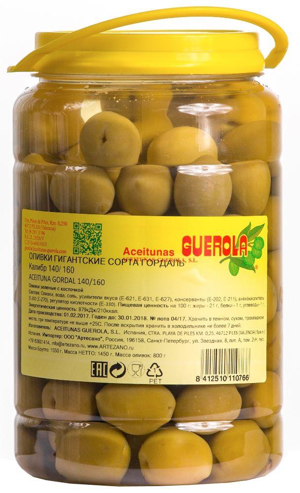 Guerola оливки зеленые Годаль калибр 140/160 с косточкой, 800 г0120710Оливки зеленые Годаль (или королевские оливки) калибром 140/160 с косточкой от испанской семейной компании GUEROLA, которая была основана еще в конце 19 века в Валенсии Рафаэлем Гуэрола и до сих пор ее возглавляют члены семьи. Предприятие выпускает оливки различных видов по традиционных испанским рецептам, консервированные перцы, каперсы и ассорти из этих продуктов. Эти оливки самые большие из существующих на испанском рынке (размером с небольшую сливу). Сорт Гордаль произрастает только в Испании и Греции, но испанские ценятся значительно выше за его тонкую текстуру, гармоничный вкус и косточку маленького размера. Прекрасны как самостоятельное блюдо, так и компонент для салатов, пиццы, бутербродов, канапе, а также в качестве украшения закусок и соусов.