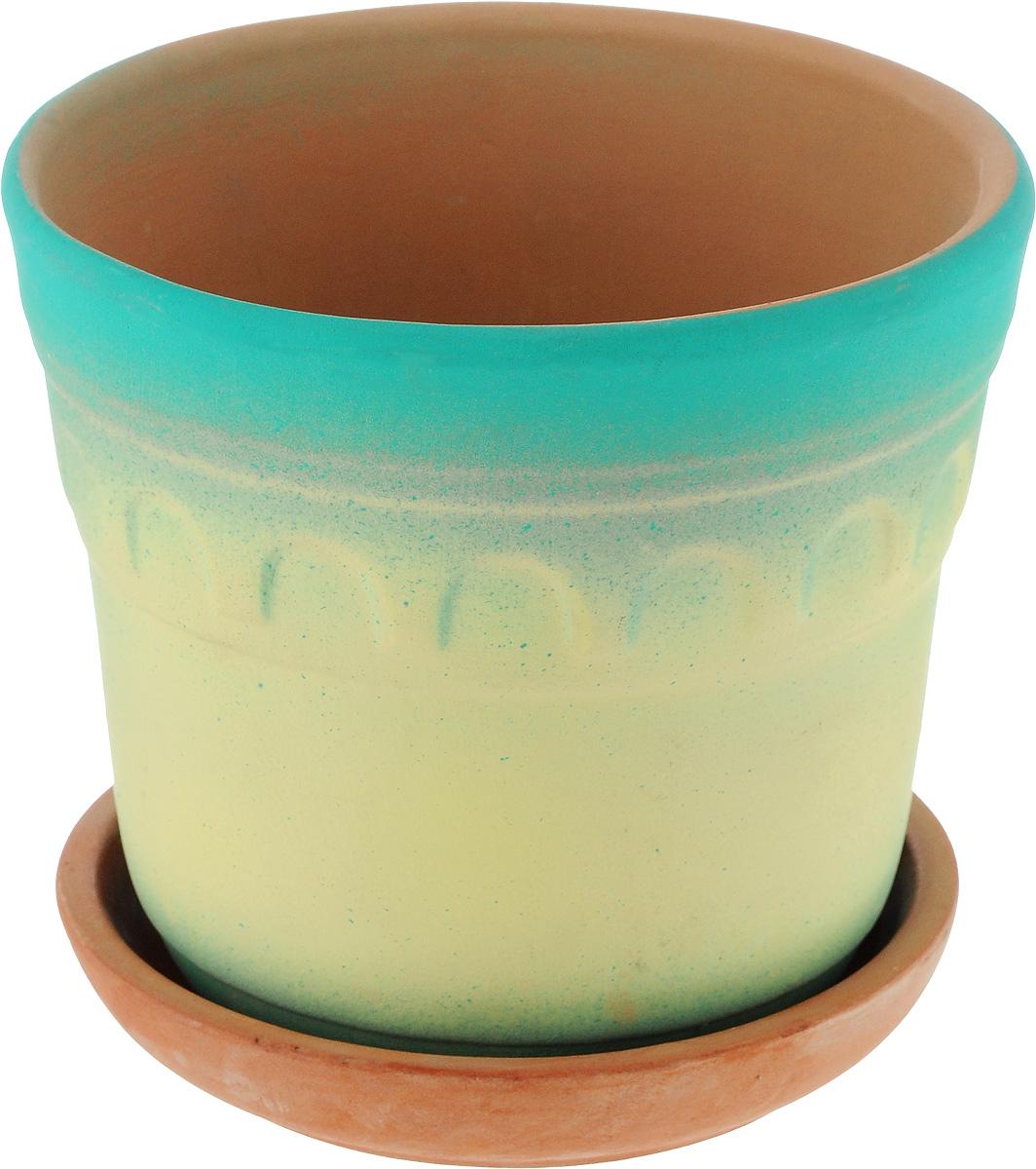 Горшок для цветов Ломоносовская керамика Элин, цвет: желтый, бирюзовый, диаметр 14 см3Це3-1Горшок с поддоном Ломоносовская керамика Элин выполнен из керамики. Внешние стенки изделия покрыты глазурью. Стенки имеют рельефный узор и окрашены в яркие цвета.Горшок предназначен для выращивания цветов, растений и трав. Он порадует вас функциональностью, а также украсит интерьер помещения. Диаметр горшка (по верхнему краю): 14 см. Высота горшка: 12 см. Размер поддона: 12 х 12 х 3 см.