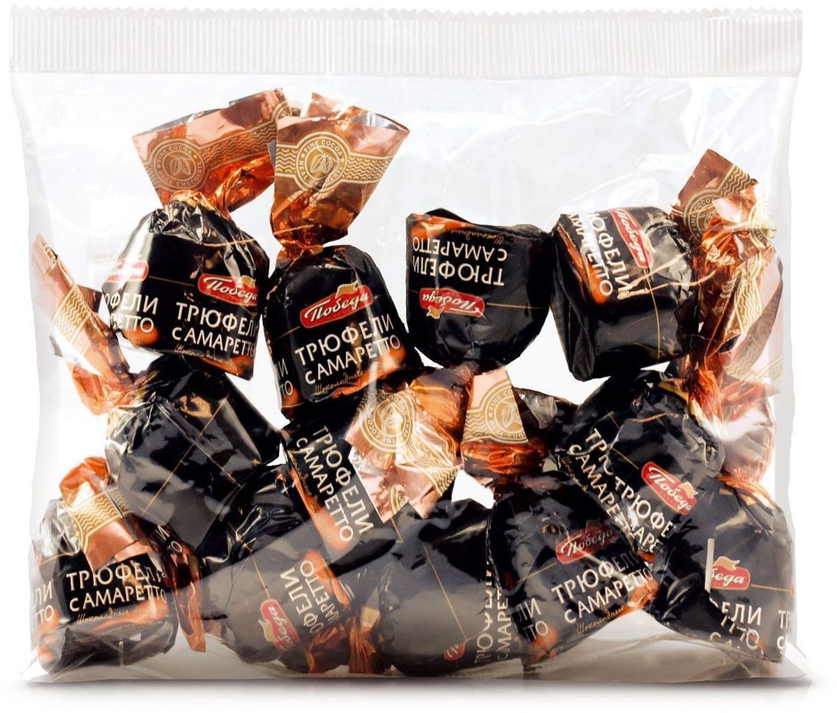 Победа вкуса Трюфели с амаретто шоколадные конфеты, 200 г541Трюфели салкоголем откондитерской фабрики Победа - премиум-десерт, созданный поклассическому рецепту. Нежная трюфельная масса изсливок ишоколада пропитана амаретто иокружена нежной оболочкой изсливочного шоколада. Как и все разновидности трюфелей от кондитерской фабрики Победа, трюфели с алкоголем произведены из высококачественного сырья с применением современных технологий.