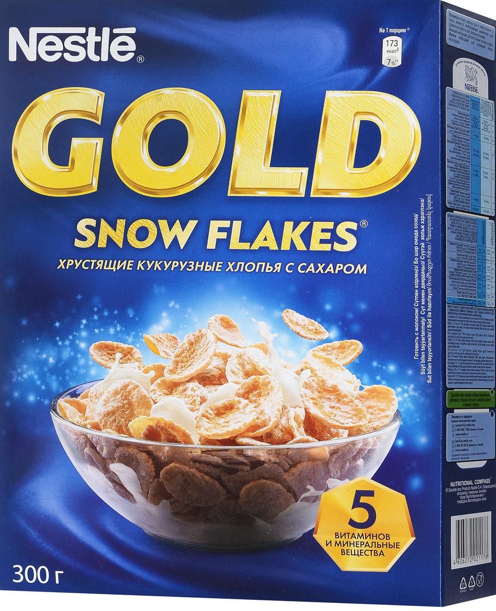 Nestle Gold Snow Flakes готовый завтрак, 300 г0120710Готовый завтрак Nestle Gold Snow Flakes - это отличный завтрак для всей семьи. Хрустящие кукурузные хлопья с сахаром дополнительно обогащены комплексом витаминов. Каждая порция готового завтрака более чем на 15% удовлетворяет рекомендуемую суточную потребность в витаминах B2, B3 (ниацине), B5 (пантотеновой кислоте), B6 и B9 (фолиевой кислоте). Вы любите начинать утро с полезного, качественного и вкусного завтрака? Вы привыкли выбирать для себя только самое лучшее? Тогда кукурузные хлопья Gold Snow Flakes - для вас! Хлопья рекомендуется употреблять с молоком, кефиром, йогуртом или соком.