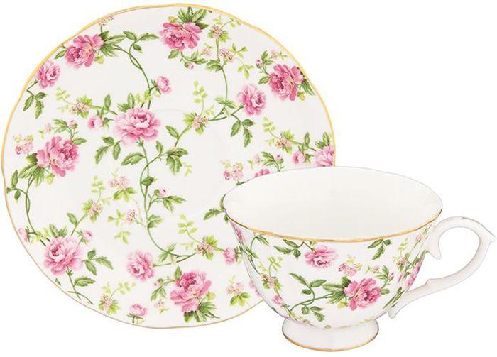 Чайная пара Elan Gallery Плетистая роза, 2 предмета115610Шикарная чайная пара на 1 персону в нежных тонах станет памятным подарком. В комплекте 1 чашка на ножке объемом 250 мл, 1 блюдце. Изделие имеет прозрачную подарочную упаковку с бантиком, поэтому станет желанным подарком для Ваших близких, коллег и друзей!