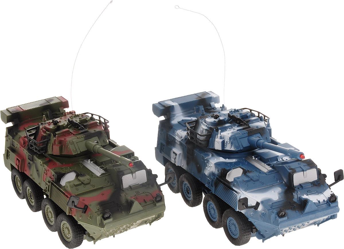 """Набор бронетранспортеров """"Balbi"""" включает в себя два игрушечных танка, впечатляющих своим ярким внешним видом и мобильностью. Дизайн бронетранспортеров повторяет собой детали реальных прототипов. Ребенок с удовольствием ознакомится с их устройством, и с нетерпением будет ждать игры с ними. И первый бронетранспортер, и второй управляются дистанционно. Для управления машинами в комплекте предусмотрены пара пультов управления. Разобраться с принципом их работы не составит для ребенка труда. Кроме того пульты имеют разную расцветку, чтобы не перепутать их во время игры и сразу выбрать тот, который подходит к конкретному танку. Танки могут двигаться вперед-назад, налево-направо.Звуковые и световые эффекты сделают игру более насыщенной и добавят больше красок. Набор окажется замечательным вариантом и для одиночной игры, и для игры в компании, где можно будет устроить настоящую схватку!Для работы каждого танка необходимо купить по 3 батарейки напряжением 1,5V типа АА (не входят в комплект). Для работы каждого пульта управления необходимо купить по 2 батарейки напряжением 1,5V типа АА (не входят в комплект)."""