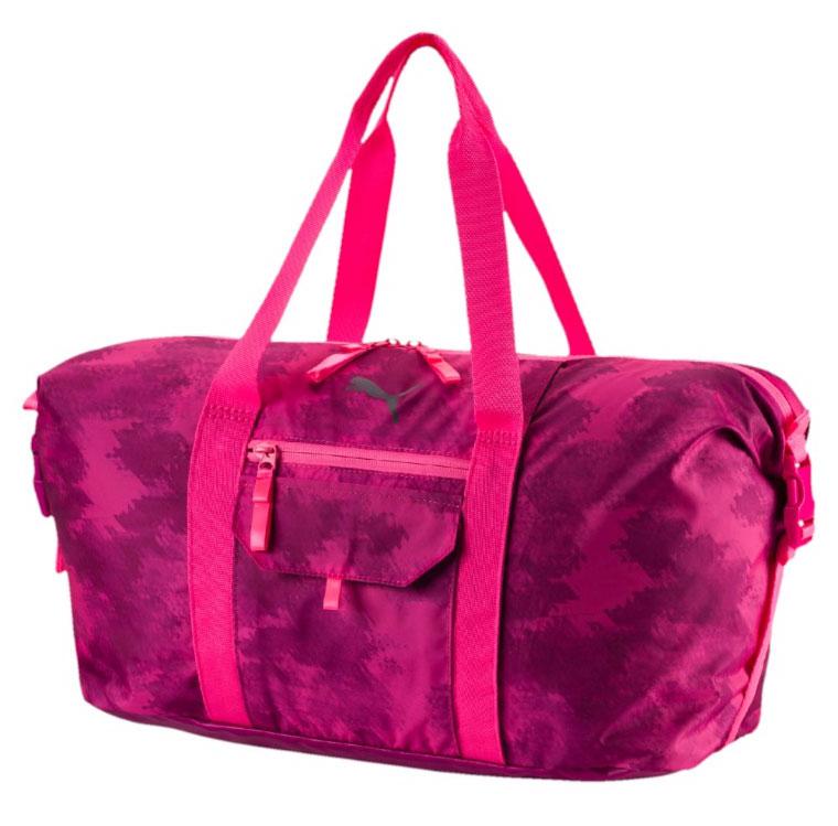 Сумка спортивная женская Puma Fit At Workout Bag, цвет: розовый. 0743740210931-1Сумка Fit At Workout Bag создана для ценителей спорта. В ней удобно носить форму для тренировок, кроме того, она подойдет для путешествий. Большой основной карман дополнен маленькими отделениями для мелочей. С помощью боковых ремней можно регулировать объем сумки.У модели двухсторонняя застежка-молния основного отделения, сетчатый карман сбоку, карман на застежке-молнии спереди, карман для мелочей на застежке-липучке на верхней части, имеется отделение для крепления коврика для йоги. Рукоятки выполнены из тесьмы. Регулируемая по длине плечевая лямка. Тканые язычки у молний. Регулируемые ремни с пряжками по бокам для корректировки объема. Вышитый логотип бренда на передней части.