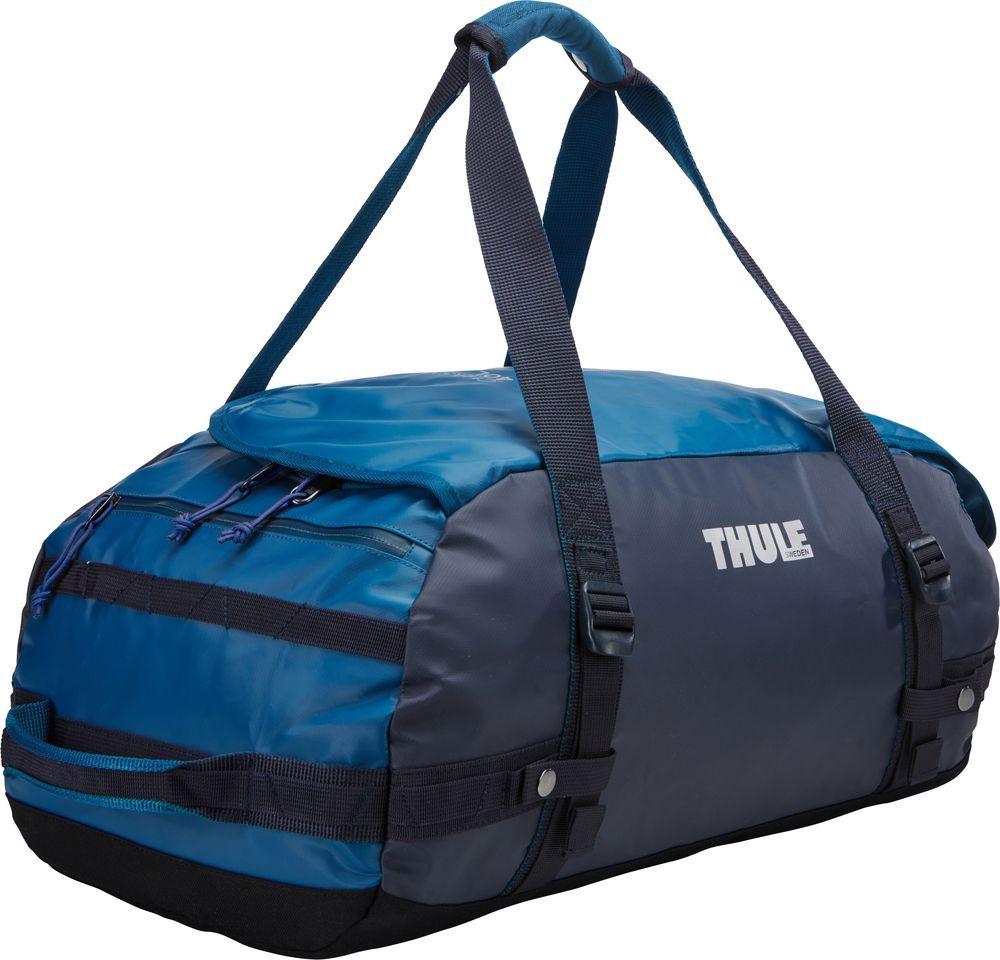 Спортивная сумка-баул Thule Chasm, цвет: синий, 40 л. Размер S221102Спортивная сумка-баул Thule Chasm - эти жесткие, устойчивые к неблагоприятным погодным условиям сумки с широко раскрывающимся основным отделением и съемными ремнями - ваши надежные спутники в любой поездке.Особенности:Увеличенный угол открывания облегчает доступ к содержимому. Возможны два способа переноски: в качестве рюкзака и спортивной сумки (все неиспользуемые ремни можно убрать). Прочная водонепроницаемая брезентовая ткань защищает вещи, а также легко складывается для компактного хранения. Внутренние сетчатые карманы помогают сортировать и хранить вещи. Внешние стягивающие ремни удерживают вещи так, чтобы они не падали на дно сумки, когда сумка становится рюкзаком. Мягкое дно защитит вещи при контакте с землей. Запирающийся боковой карман на молнии позволяет надежно хранить небольшие предметы под рукой (замок продается отдельно). Быстрый доступ к небольшим предметам через внешний потайной карман.