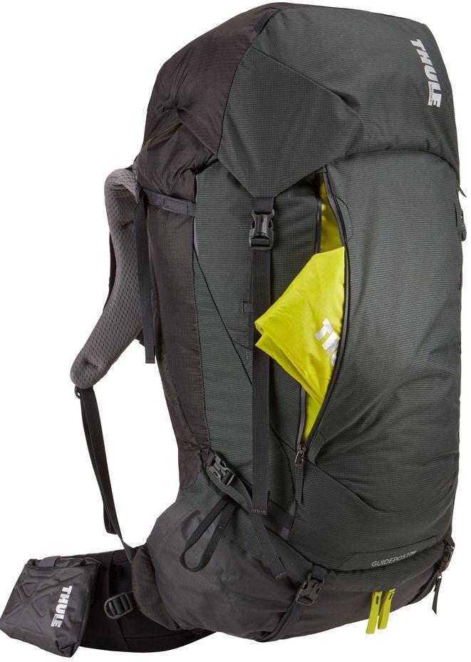 Рюкзак туристический мужской Thule Guidepost, цвет: темно-серый, 75 л222100Удобный рюкзак для длительных путешествий Thule Guidepost с объемом 75 л отличается настраиваемой системой крепления TransHub, обеспечивающей идеальную посадку, поворачивающимся набедренным ремнем, который позволяет рюкзаку повторять ваши движения, и крышкой, способной трансформироваться в дополнительный рюкзак, который поможет вам покорить любую вершину.Лямки с шагом 15 см легко регулируются для идеальной посадки рюкзака, а наплечные ремни QuickFit имеют три варианта длины.Система крепления Transhub и усиленный поясной ремень помогают максимально перенести вес рюкзака на бедра, обеспечивая более удобную посадку.За счет поворотного поясного ремня рюкзак повторяет ваши движения, обеспечивая более естественную ходьбу.Съемный верхний клапан трансформируется в отдельный просторный рюкзак объемом 28 л.Съемный всепогодный сворачивающийся карман VersaClick защищает снаряжение от непогоды.Регулируемый поясной ремень совместим со взаимозаменяемыми аксессуарами VersaClick (продаются отдельно).Яркий съемный дождевой чехол поможет сохранить вещи сухими во время проливного дождя.Разместив внешний аккумулятор в отделении PowerPocket, можно на ходу заряжать мобильное устройство в кармане поясного ремня.Удобный доступ к содержимому рюкзака благодаря большой J-образной застежке на молнии на боковой панели.Дышащая задняя панель способствует лучшей циркуляции воздуха, а мягкая опора обеспечивает поддержку в главных точках соприкосновения.