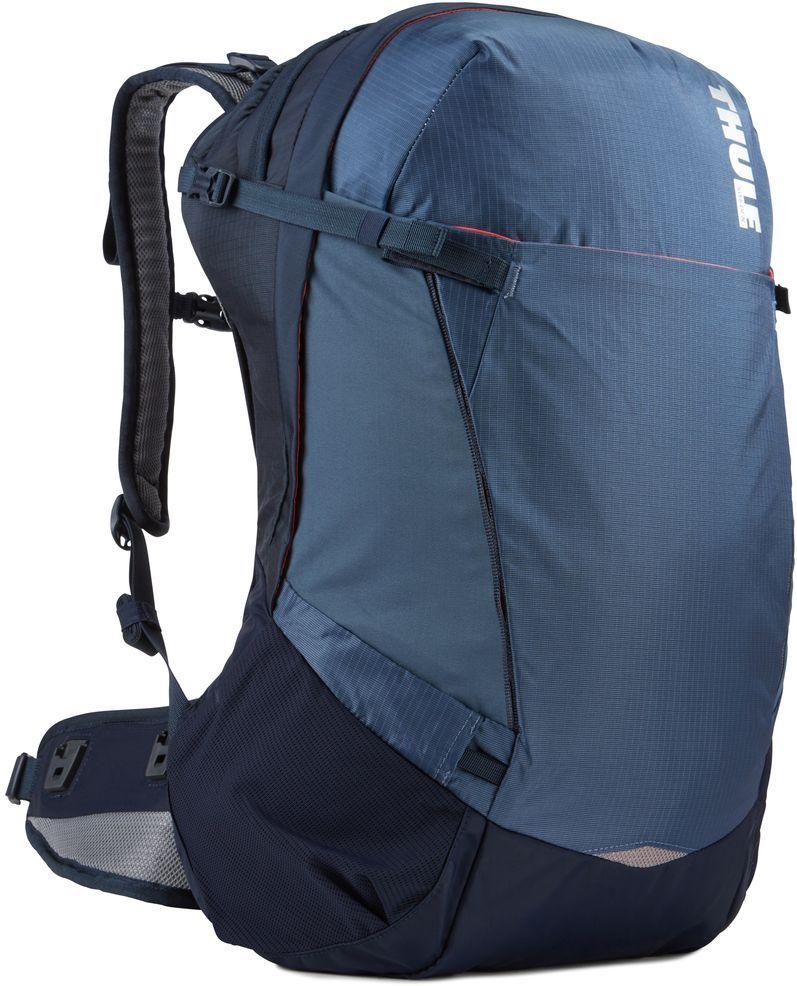 Рюкзак туристический женский Thule Capstone, цвет: синий, 32 л224103Женский туристический рюкзак Thule Capstone подходит для путешествий на целый день, имеет регулируемую подвеску, воздухопроницаемую заднюю панель и вшитый дождевой чехол.Система крепления MicroAdjust позволяет отрегулировать ремень для торса на 10 см при надетом рюкзаке, чтобы добиться идеальной посадки.Сеточная задняя панель натягивается, обеспечивая превосходную воздухопроницаемость и позволяя вам не потеть и оставаться сухим в пути.Яркая съемная накидка от дождя обеспечивает сухость ваших принадлежностей во время ливнейРегулируемый поясной ремень совместим со взаимозаменяемыми аксессуарами VersaClick (продаются отдельно).С помощью держателя палок VersaClick, входящего в комплект поставки, можно удобно закрепить треккинговые палки на поясном ремне, не снимая рюкзак.Карман на молнии в верхней части рюкзака предназначен для хранения небольших предметов.В карман на поясном ремне можно положить еду, телефон или небольшие предметы.Эластичный карман Shove-it Pocket обеспечивает быстрый доступ к часто используемым предметам.Можно легко переместить снаряжение в переднюю часть рюкзака с помощью ремешка, продетого сквозь прочную петлю.Задние крепления для треккинговых палок и ледоруба можно убрать, если они не используются.