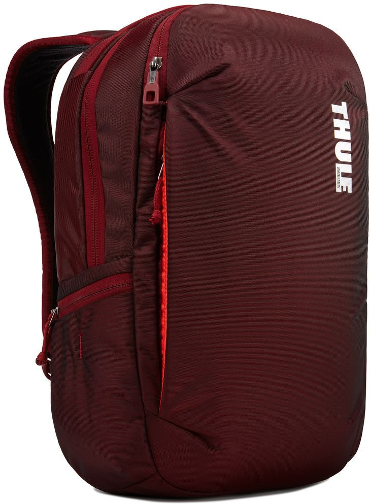 Рюкзак городской Thule Subterra Backpack, цвет: темно-бордовый, 23 л3203439Вместительный и прочный дорожный рюкзак с функцией защиты электроники и отделением PowerPocket для упорядоченного хранения шнуров и зарядных устройств.Отделение с мягкой подкладкой и конструкцией SafeEdge для ноутбука (MacBook Pro с диагональю экрана 15 дюймов или ПК с диагональю экрана 15,6 дюйма).Специальный защитный карман с мягкой подкладкой для планшета.От внешнего аккумулятора во внутреннем отделении PowerPocket удобно заряжать различные устройства.Доступ к ноутбуку из верхнего отделения или через боковую молнию.Перфорированные наплечные ремни EVA с сетчатым покрытием и мягкой задней подушкой, пропускающие воздух, обеспечивают комфорт.Съемный регулируемый нагрудный ремень фиксирует наплечные ремни рюкзака и делает транспортировку более комфортной.Специальная панель для надежного крепления к дорожным сумкам на колесах помогает путешествовать с удобством.Внутренний карман с мягкой подкладкой для ценных вещей, например очков или телефона.Удобные отделения-органайзеры упрощают размещение мелких предметов.В растягивающемся боковом кармане на молнии безопасно хранятся небольшие предметы и помещается бутылка воды.