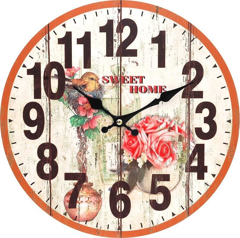 Часы настенные Белоснежка Цветы и птичка, диаметр 34 см54 009312Часы настенные Белоснежка станут изюминкой в дизайне интерьера вашего дома. Открытый циферблат выполнен из листа оргалита с декоративным покрытием. Часы имеют две стрелки – часовую и минутную. Часовой механизм сзади закрыт пластиковым корпусом. Предусмотрено отверстие для крепления на стену. Питание от одной батарейки стандарта АА (в комплект не входит).Диаметр часов: 34 см.