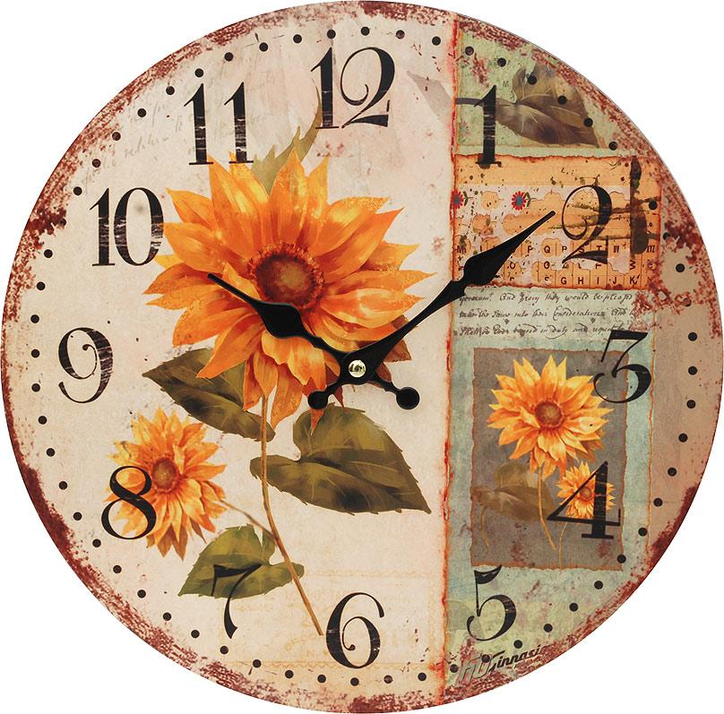 Часы настенные Белоснежка Подсолнух, диаметр 34 см54 009305Циферблат: открытый, выполнен из листа оргалита с декоративным покрытием.Стрелки металлические – часовая и минутная.Часовой механизм закрыт пластиковым корпусом.Питание от одного элемента питания стандарта АА.Отверстие для крепления часов на стену.Диаметр 34 см.