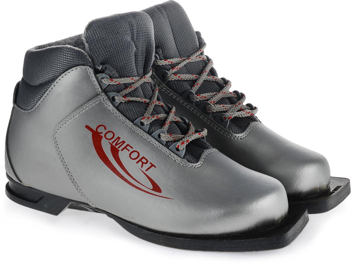 Ботинки лыжные Marax Comfort, цвет: серебро. 340Karjala Comfort NNNБотинки для беговых лыж Comfort под крепления NN 75 предназначены для активного отдыха. Модель изготовлена из высококачественного синтетического материала, протестированного при температуре -25°С.Внутри - текстильный утеплитель. Ботинки снабжены шнуровкой с пластиковыми петлями и язычком-клапаном, который защищает от попадания снега и влаги. Термопластичный анатомический задник.