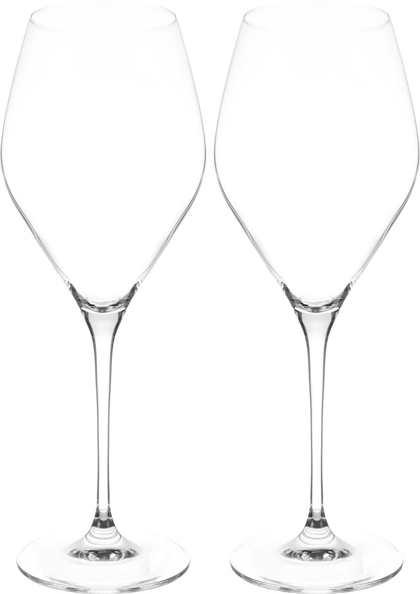 Набор бокалов для вина Wilmax, 560 мл, 2 штVT-1520(SR)Набор Wilmax состоит из двух бокалов, выполненных из прочного стекла. Изделия оснащены высокими ножками и предназначены для подачи вина. Они сочетают в себе элегантный дизайн и функциональность. Набор бокалов Wilmax прекрасно оформит праздничный стол и создаст приятную атмосферу за романтическим ужином. Такой набор также станет хорошим подарком к любому случаю. Бокалы можно мыть в посудомоечной машине.Диаметр бокала по верхнему краю: 6 см.Диаметр основания: 8,3 см.Высота бокала: 26,5 см.