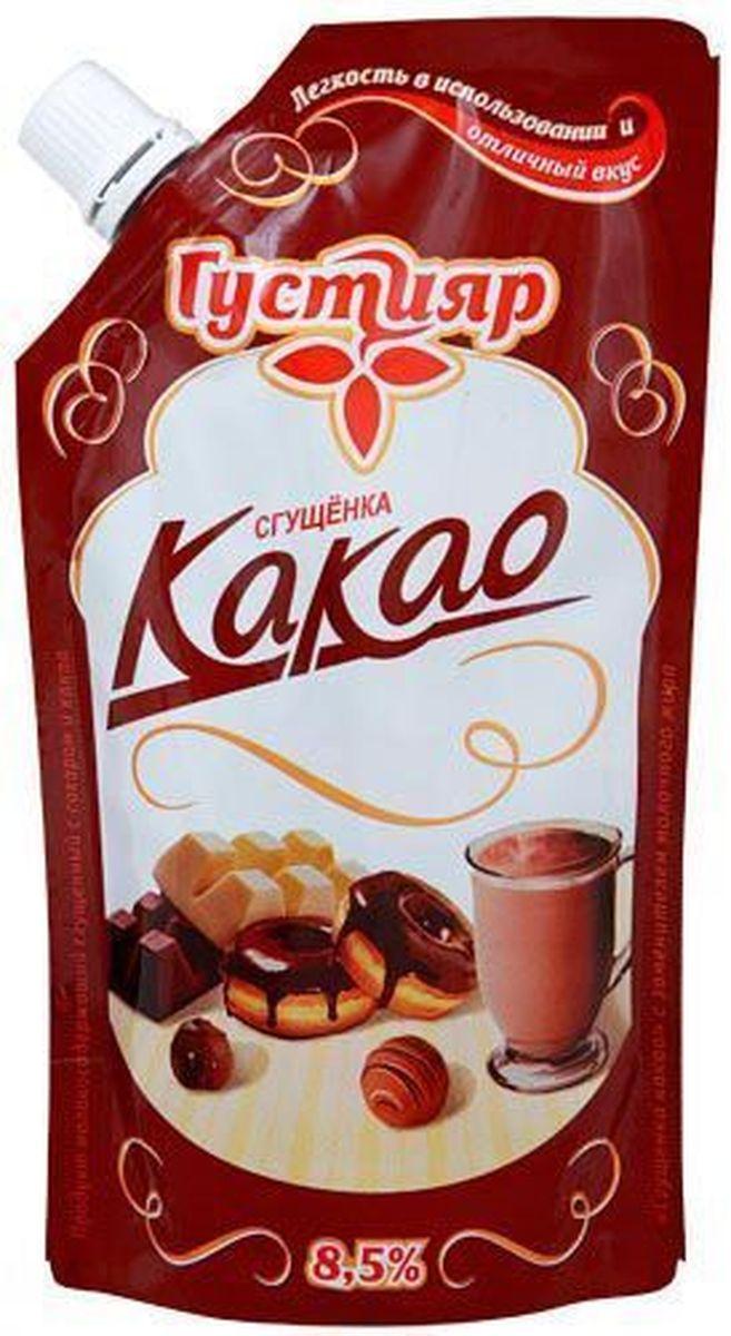 Союзконсервмолоко Густияр молоко сгущенное с какао, 270 г0120710Сгущенка Густияр с какао - продукт молокосодержащий сгущенный с сахаром и какао. Изготовлена из обезжиренного молока, сахар (сахароза, лактоза ), цельное молоко, восстановленная сухая молочная сыворотка, сливочное масло, заменитель молочного жира, какао - порошок, консервант сорбат калия. Пищевая ценность в 100 г продукта: жира-8.5 г, белков - 4 г, углеводы - 56 г. Вкус - сладкий, характерен для сгущенного молока с сахаром и какао, однородная масса.