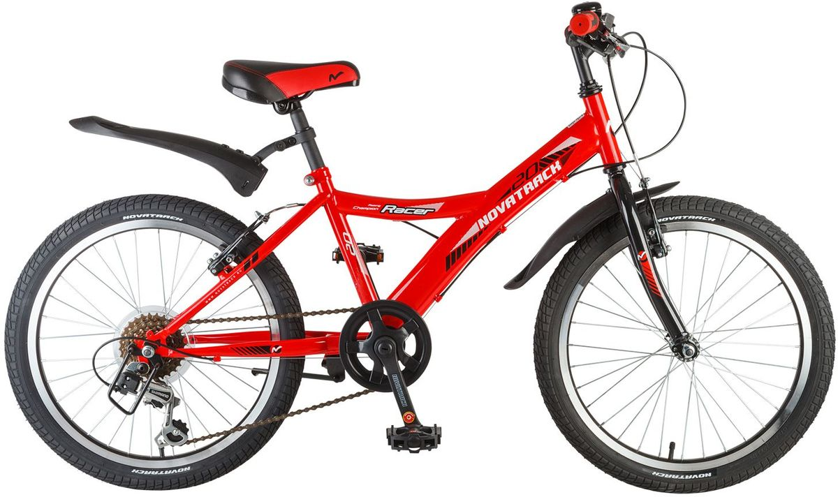 Велосипед детский Novatrack Racer, цвет: красный, 20MHDR2G/AВелосипед Novatrack Racer 20'' – это один из лучших велосипедов для ребят 7-10 лет. Привлекательный дизайн, надежная сборка, легкость и отличная управляемость – это еще не все плюсы данной модели. Низкая рама разработана таким образом, что ребенку очень легко взбираться и слезать с велосипеда, да и спрыгивать тоже, в случае непредвиденных обстоятельств во время катания. Велосипед полностью укомплектован и обязательно понравится маленькому велосипедисту: тормоза типа V-brake, переключение скоростей, а их, между прочим, целых 6, багажник для перевозки небольших грузов, блестящие катафоты, агрессивные пластиковые крылья.