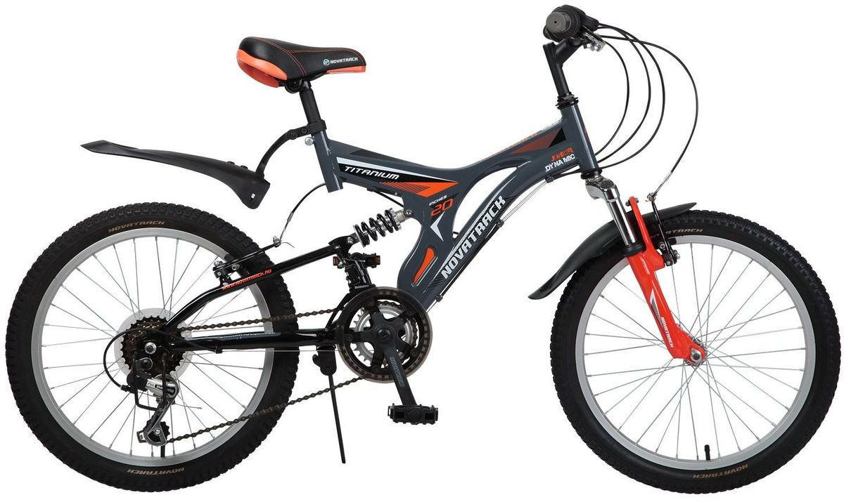 Велосипед детский Novatrack Titanium, цвет: серый, оранжевый, 20MHDR2G/ANovatrack Titanium - это модель для ребят 7-10 лет, которые уже неодобрительно относится к детским велосипедам и засматриваются на большие горные. На 20-дюймовых колесах можно кататься не только во дворе, но и по более сложным маршрутам,ухабистым парковым тропинкам, небольшим горкам, где езда без амортизаторов была бы не простой. Велосипед оснащен передним и задним ручным тормозом, которые при синхронной работе обеспечивают наилучшее торможение при спуске с наклонной поверхности, а одна из 12 скоростей помогает легко преодолеть сложный подъем. Переключение передач очень нравится мальчишкам:это атрибут велосипедов для знатоков велоспорта, коим ваше чадо быстрее мечтает стать, еще ребенок учится анализировать ситуацию и выбирать соответствующую скорость для комфортной езды. С велосипедом Novatrack Titanium ваш ребенок точно не засидится дома, а будет активно двигаться на свежем воздухе, эффективно укрепляя мышцы, совершенствуя ловкость и повышая иммунитет.