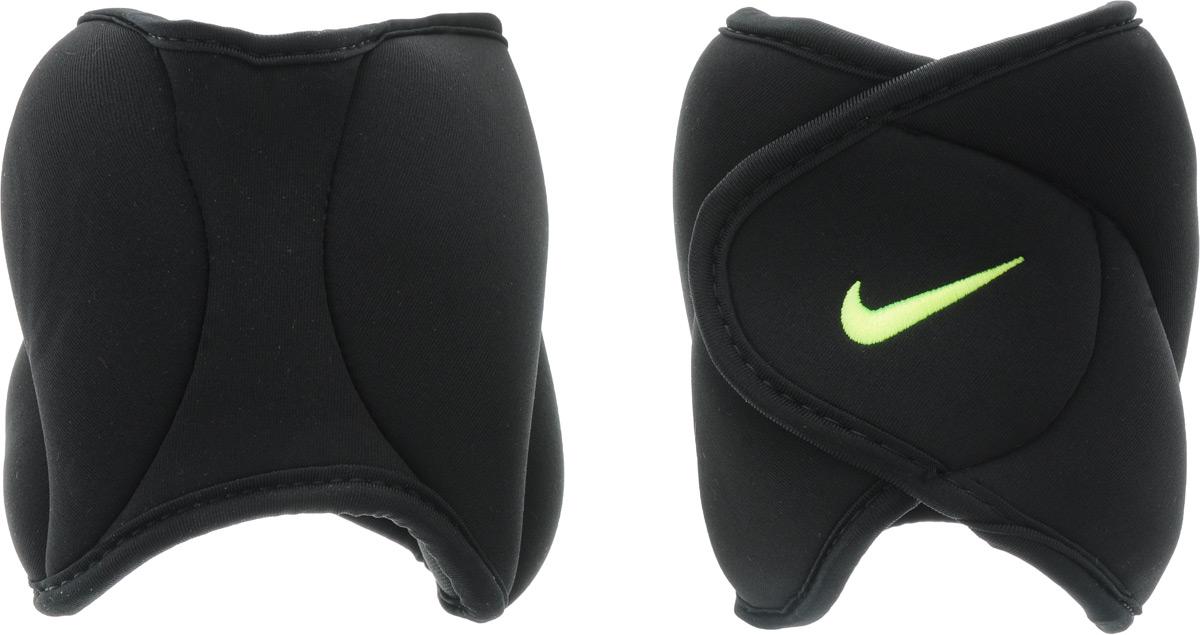 Утяжелители для ног Nike Ankle Weights, цвет: черный, желтый, 2,27 кг, 2 штУТ-00007298Утяжелители для ног Nike Ankle Weights легко фиксируются при помощи крепежной липучки. Они изготовлены из полиэстера и наполнены металлической стружкой. Быстросохнущая подкладка Fit Dry быстро впитывает влагу, что позволяет оставаться коже всегда сухой и не потеть. Идеальны в использовании при занятиях бегом, аэробикой, оздоровительной гимнастикой и фитнесом.Мягкий материал надежно облегает, давая вместе с тем ощущение свободы рукам - у вас отпадает необходимость держать гантели или гири для создания усилий во время тренировок. Модель имеет преимущество перед универсальными утяжелителями за счет анатомически комфортной конструкции, обеспечивающей идеальную посадку на лодыжке. Вес каждого утяжелителя: 2,27 кг. Длина утяжелителя: 37 см. Ширина утяжелителя: 16 см.Толщина утяжелителя: 3,5 мм.